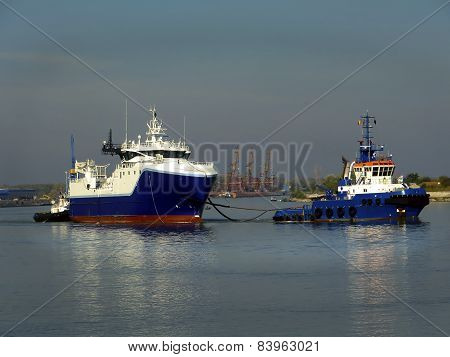 Tug Boat and Cargo Ship