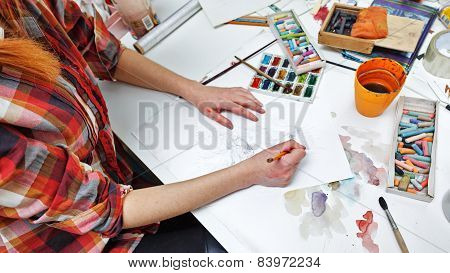 Hands Of An Artist Working With Pencil Sketch