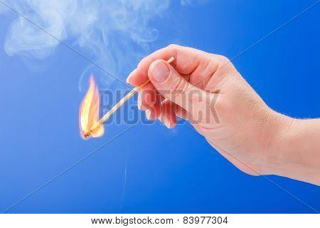 Hand Holding A Burning Matchstick