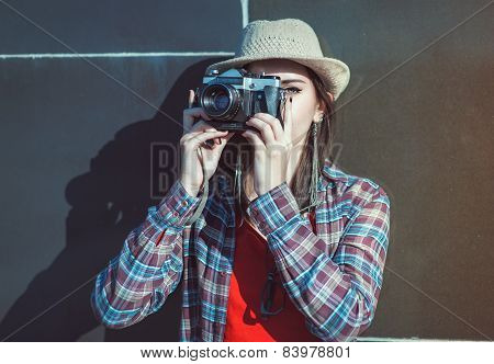Beautiful Hipster Girl In Hat Making Picture With Retro Camera