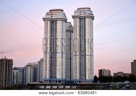 Urban high-rise house on a background of sunset