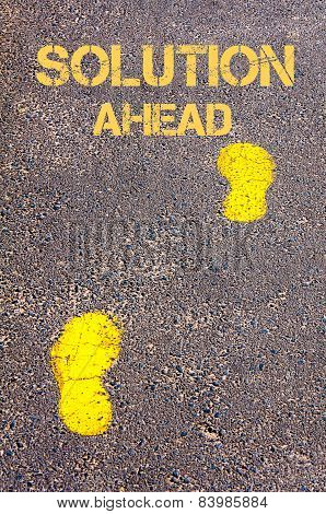 Yellow Footsteps On Sidewalk Towards Solution Ahead Message