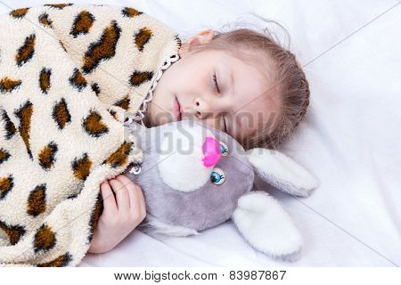 Sleeping girl with a toy hare