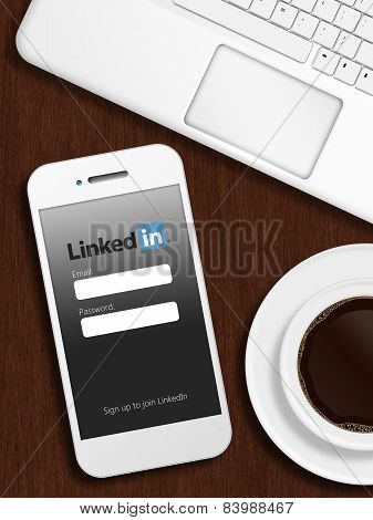 Gdansk, Poland - October 24, 2014: Mobile Phone With Linkedin Login Page Lying On Desk With Coffee A