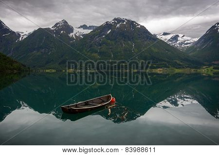 An Old Boat And Some Mountains...
