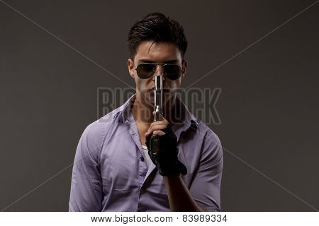 Shooter With Gun And Gloves
