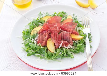 Delicious Italian Fresh Salad With Bresaola Arugula And Cheese On White Plate