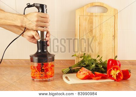 Hands chefs chopped red pepper in blender