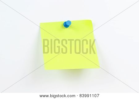 Green sticker on white message board