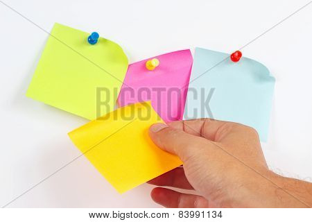 Hand sticker sticks on white message board