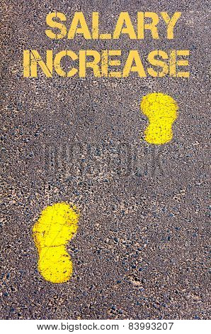 Yellow Footsteps On Sidewalk Towards Salary Increase Message