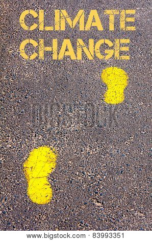 Yellow Footsteps On Sidewalk Towards Climate Change Message