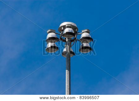 Top Of Flood Lights Pointing Down On Sky