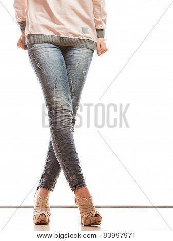 Woman Legs In Denim Trousers High Heels Shoes