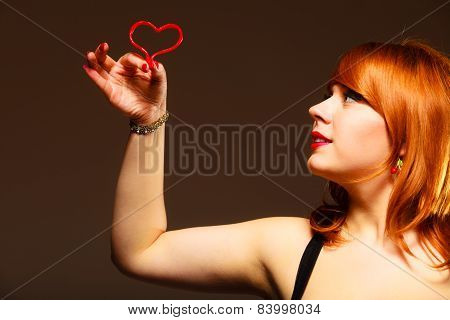 Gorgeous Young Woman Holding Candy Heart.