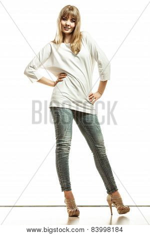 Blonde Fashion Woman In White Shirt Denim Pants