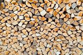 image of cleaving  - Stack of cleaved firewood as tree trunks - JPG