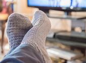 pic of stocking-foot  - Propped up feet in front of the TV - JPG
