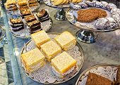 stock photo of biscuits  - Assorted cookies biscuits and cakes on the bakery storefront - JPG