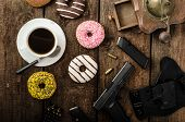 picture of cap gun  - American police officer morning donuts juice fresh black coffee and his gun - JPG