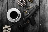 image of cap gun  - American police officer morning donuts juice fresh black coffee and his gun - JPG