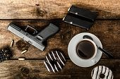 stock photo of cap gun  - American police officer morning donuts juice fresh black coffee and his gun - JPG
