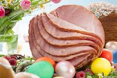 image of ester  - Whole baked honey sliced ham with fresh raspberry asparagus dyed Ester eggs Easter cake and cross buns - JPG