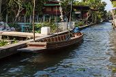 pic of street-rod  - a small thai motorboat moored in a countryside village in the Ratchaburi province Thailand - JPG