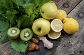 stock photo of nettle  - ingredients for shake nettles with kiwi apples and ginger detox drink for a vegetarian diet - JPG