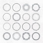 stock photo of adornment  - Round handdrawn wreaths on texturized vintage background - JPG