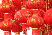 stock photo of chinese crackers  - chinese red lantern and fake firecrackers - JPG