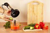 foto of blender  - Hands chefs put chopped cucumber in a blender - JPG