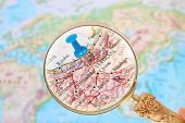 stock photo of tehran  - Blue tack on map of the world with magnifying glass looking in on Tehran Iran Asia - JPG