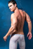 picture of single man  - a man is taking a shower looking back - JPG