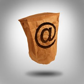 stock photo of ampersand  - Digital identity and private or anonymous social network user on the internet as a brown paper bag with a hole shaped as the email symbol with an ampersand icon - JPG