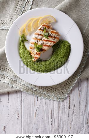 Chicken And A Side Dish Of Green Peas  Vertical Top View