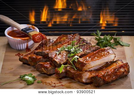 Barbecued Ribs and Flaming Grill