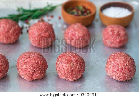 Cooking meatballs of ground beef with spices