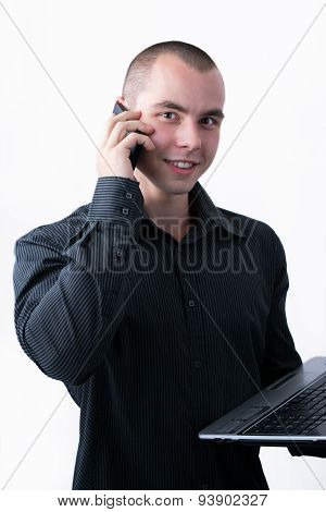 Man Browsing Internet On His Laptop While Calling