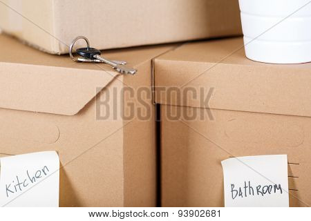 Pile Of Brown Cardboard Boxes With House Or Office Goods