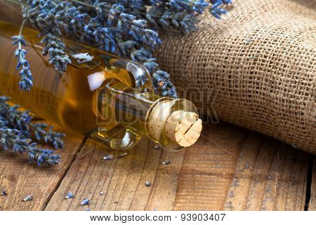 Essential Oil Botle And Lavender Flowers