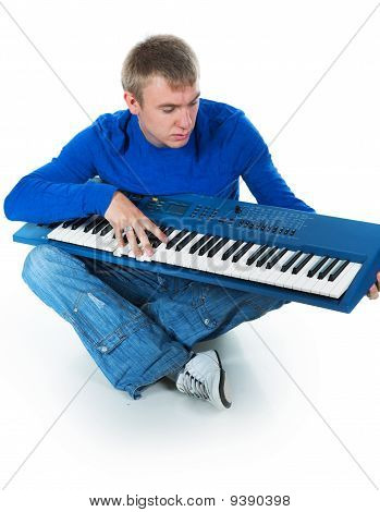 Young Man With An Electronic Piano