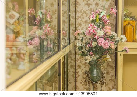 artificial fake flower bouquet on blurred background