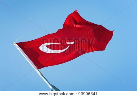 Waving Flag Of Turkey. Red Turkish Flag On The Blue Sky.