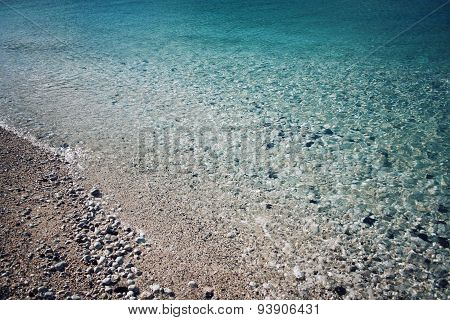 Pebble Beach. Blue Water. Rocky Shore. Southern Coast Of Turkey.
