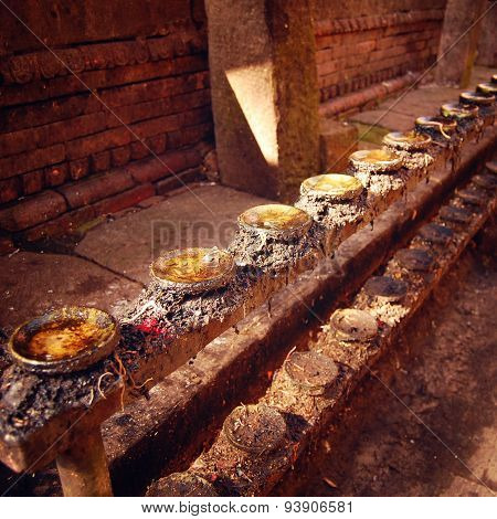 Racks For Candles In Buddhist Shrine Swayambhunath Stupa. Aged Photo.