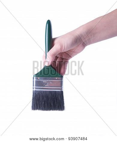 Paint Brush With Hand On A Background.