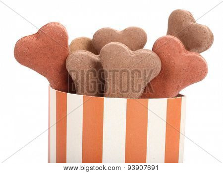 Snack food for dogs biscuits shaped as bone in striped box