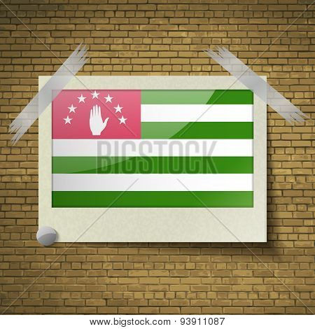 Flags Abkhazia At Frame On A Brick Background. Vector