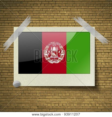 Flags Afghanistan At Frame On A Brick Background. Vector